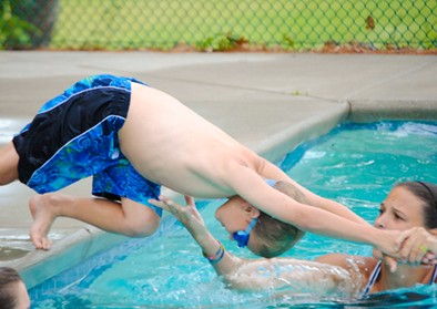boy-diving-counselor