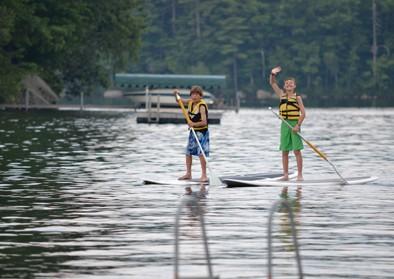 boys-paddle-board