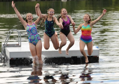 girls-waterfront-jump